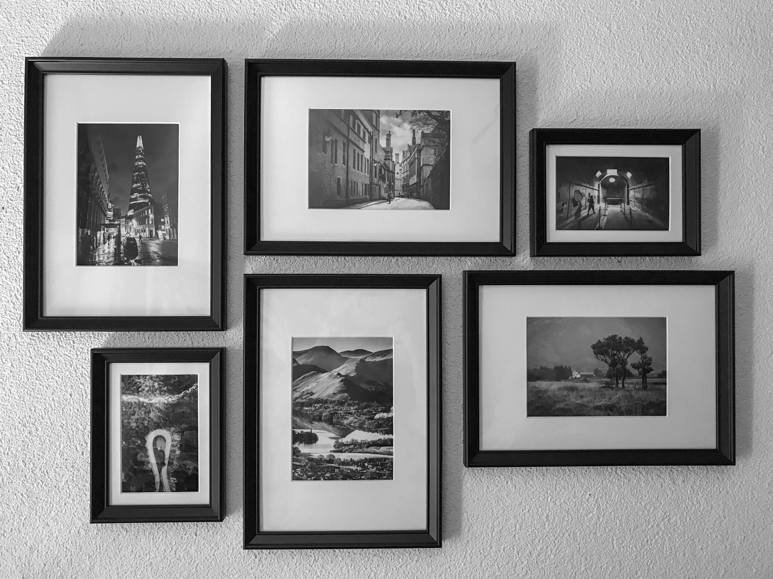 Black-and-white photos on my office wall