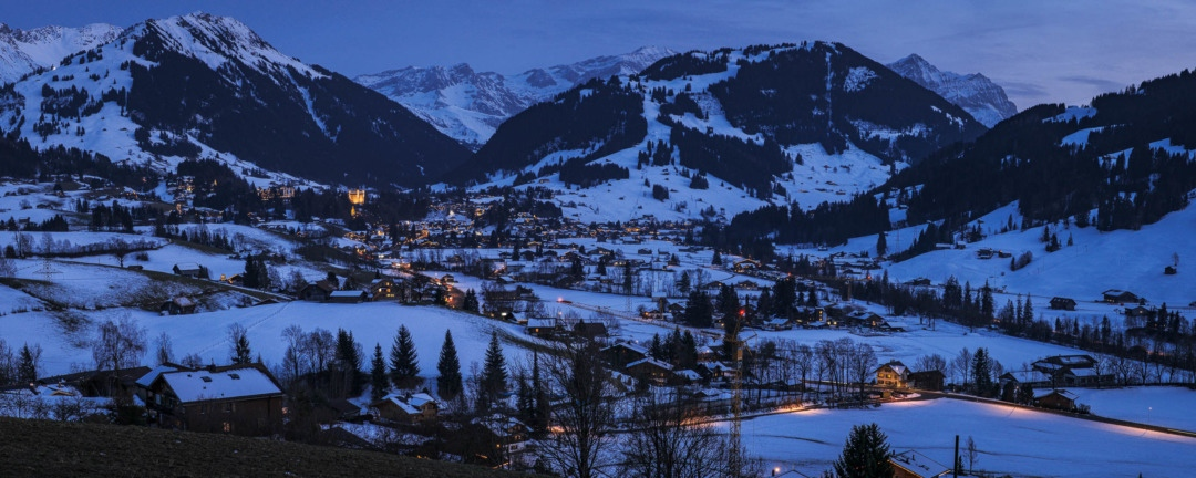 Panorama photo of Gstaad at blue hour