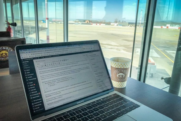 Working with WordPress on a laptop at an airport