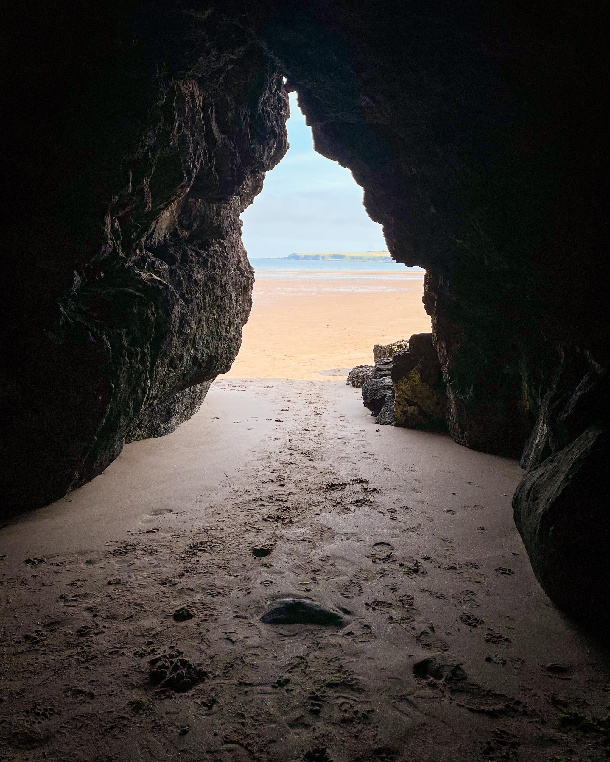 Cave on Lunan Bay beach