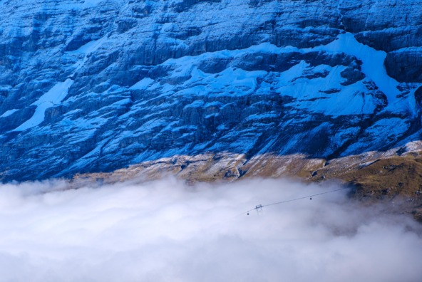 Cable cars emerging from a cloud inversion at Grindelwald